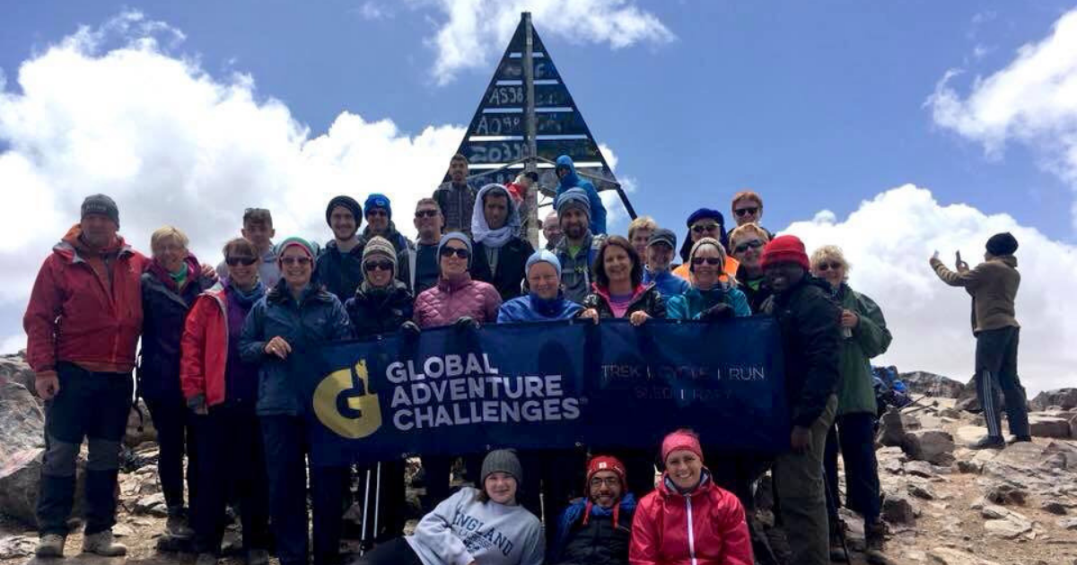 Group of participants stood at the summit of Mount Toubkal