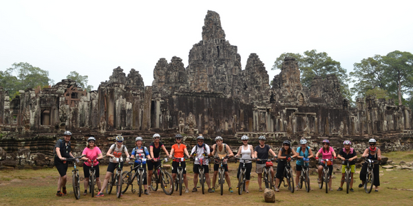 Cyclists outside of Angkor Wat, Cambodia